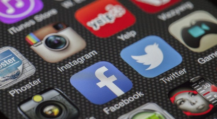 A photo of a screen displaying social media icons (applications)